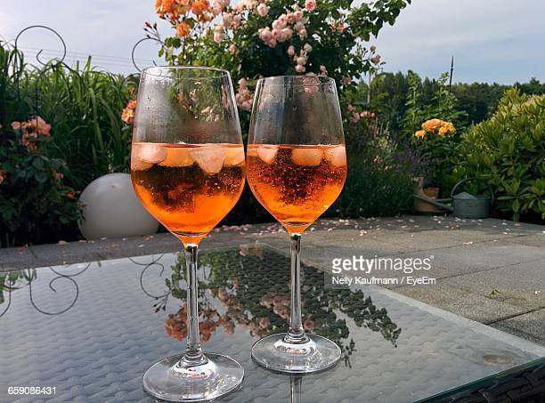 Close-Up Of Aperol Spritz In Wineglass On Table At Restaurant