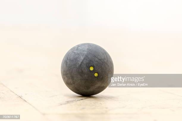 Close-Up Of Squash Ball On Court