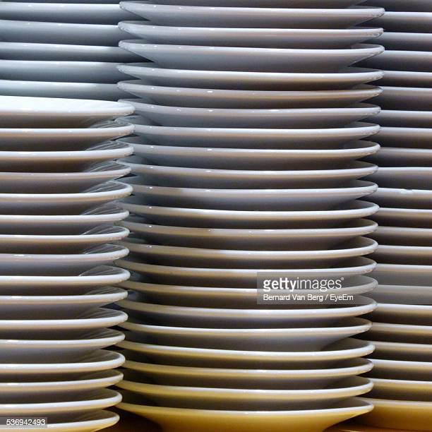 Close-Up Of Stack Of White Porcelain Plates