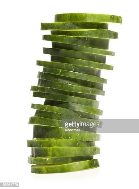 Close-up of stacked slices of cucumber (Cucumis sativus)
