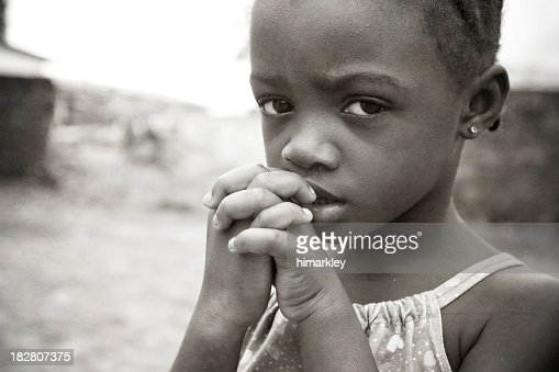 Close-up of starving African girl biting her nail
