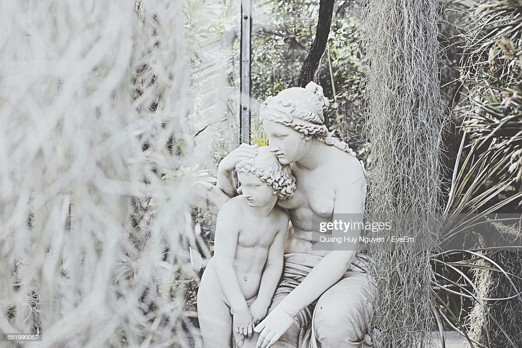 Close-Up Of Statue At Formal Garden