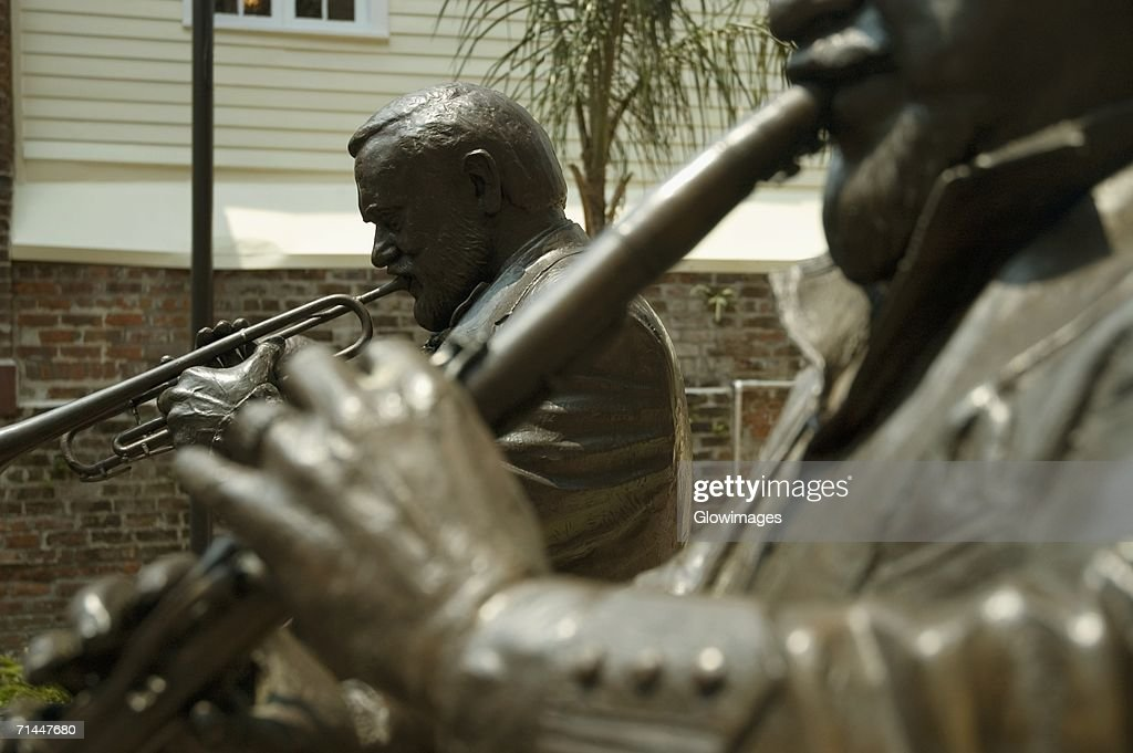 Close-up of statues of two musicians playing musical instruments, New Orleans, Louisiana, USA : Stock Photo