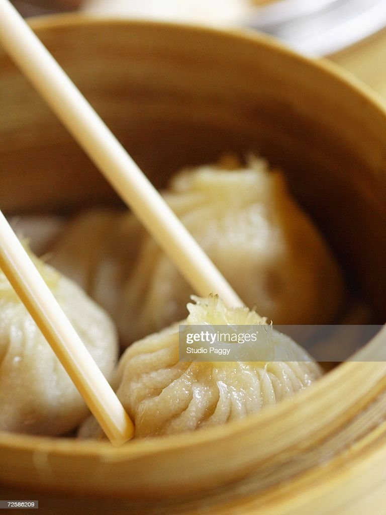 Close-up of steamed xiaolongbao in a steamer basket : Stock Photo
