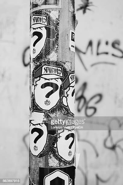 Close-Up Of Stickers On Wooden Post