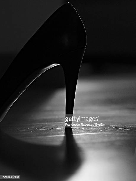 Close-Up Of Stilettos On Floor