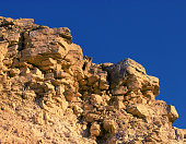 Close-up of stone rock with blue sky above