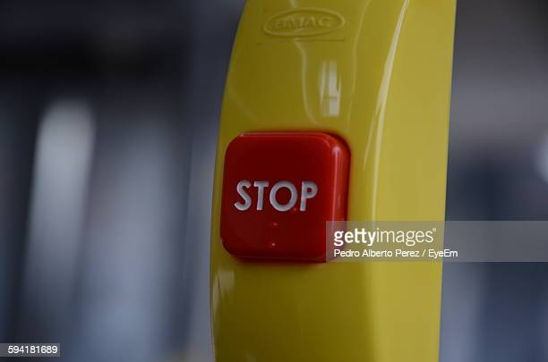 Close-Up Of Stop Button On Handle In Bus