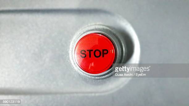 Close-Up Of Stop Button On Metal