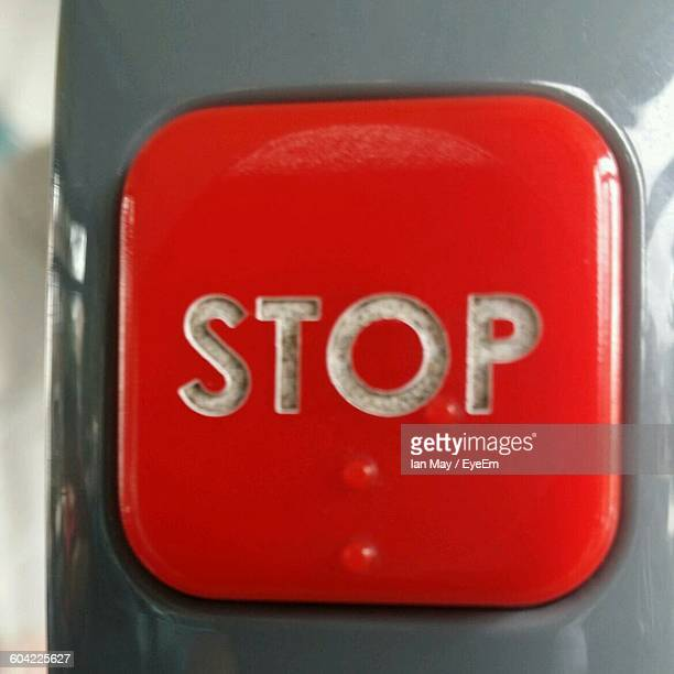 Close-Up Of Stop Sign On Pole In Bus