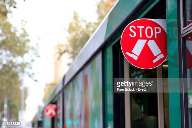 Close-Up Of Stop Sign On Tram
