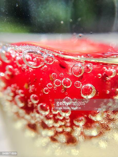 Close-Up Of Strawberry In Champagne
