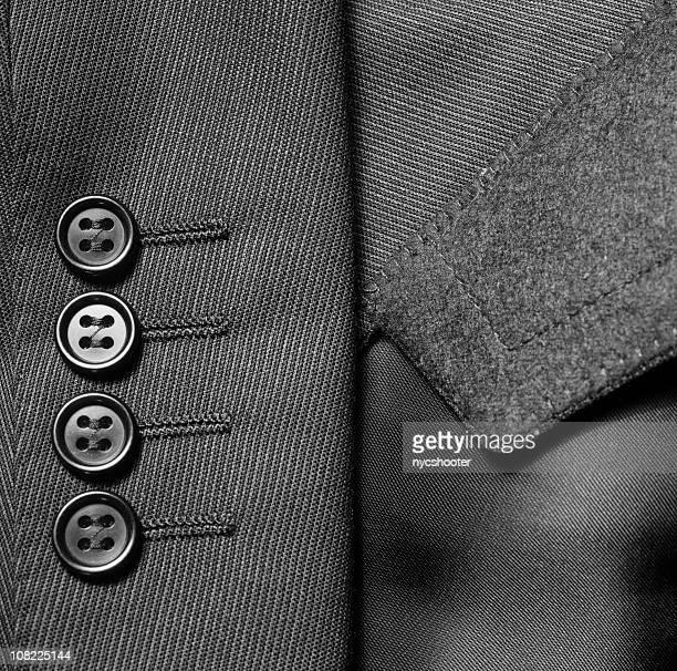 Primer plano de traje chaqueta de vestir botones