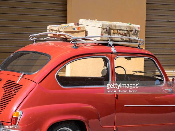 Close-Up of suitcases on car trunk, ancient car loaded with ancient suitcases of leather. Valencia, Spain