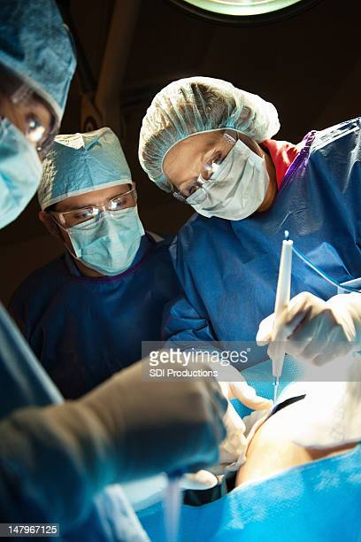 Closeup of surgeons performing Caesarean Section
