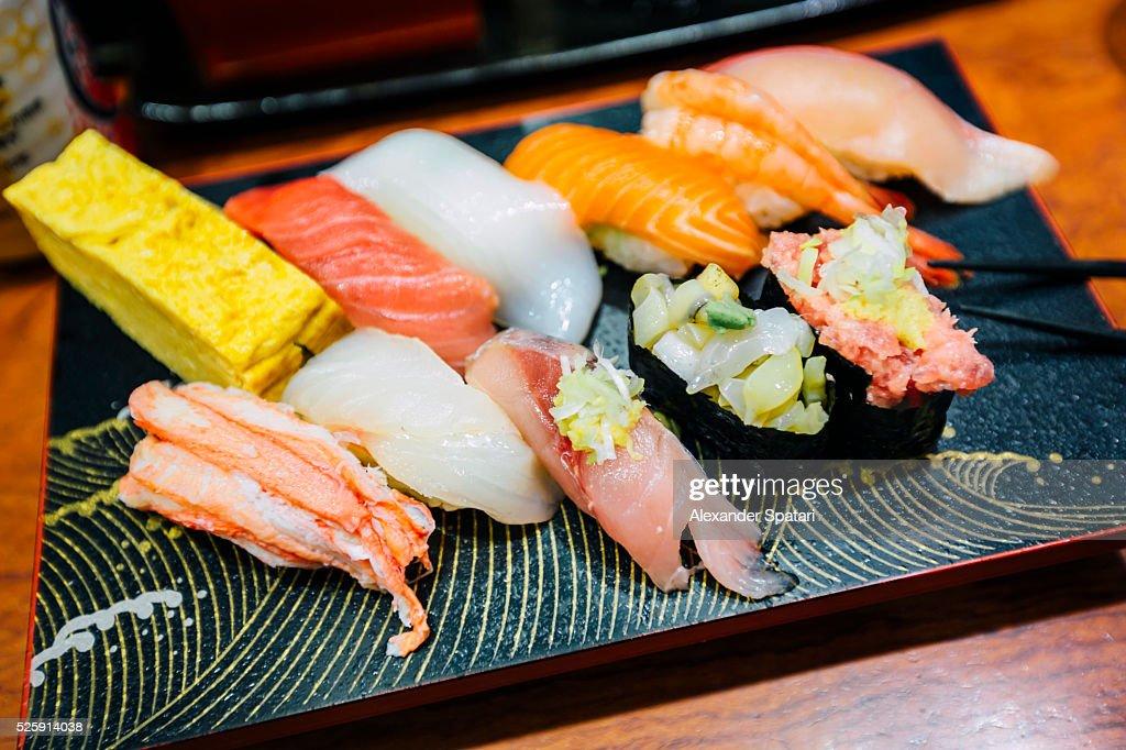 Close-up of sushi set on board