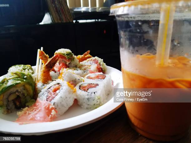 Close-Up Of Sushi With Drink On Table