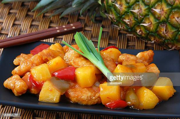 Close-up of sweet and sour chicken with pineapples