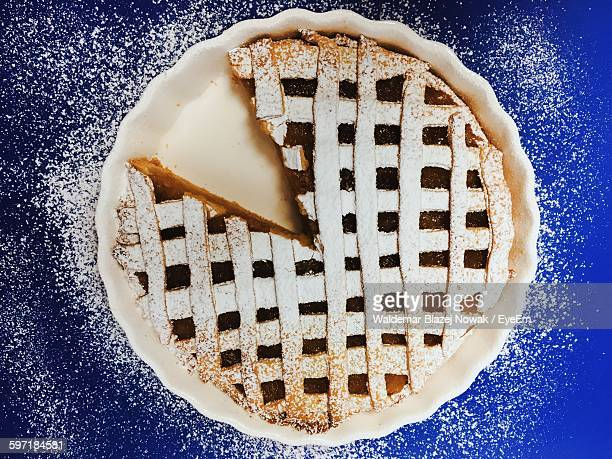 Close-Up Of Sweet Pie With One Slice Removed