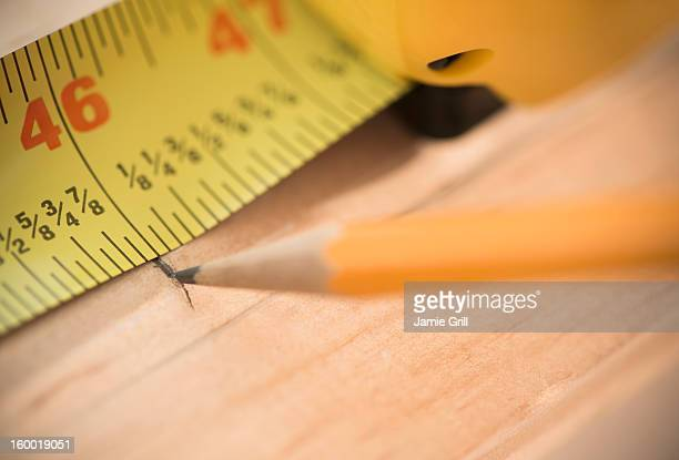 Close-up of tape measure and pencil