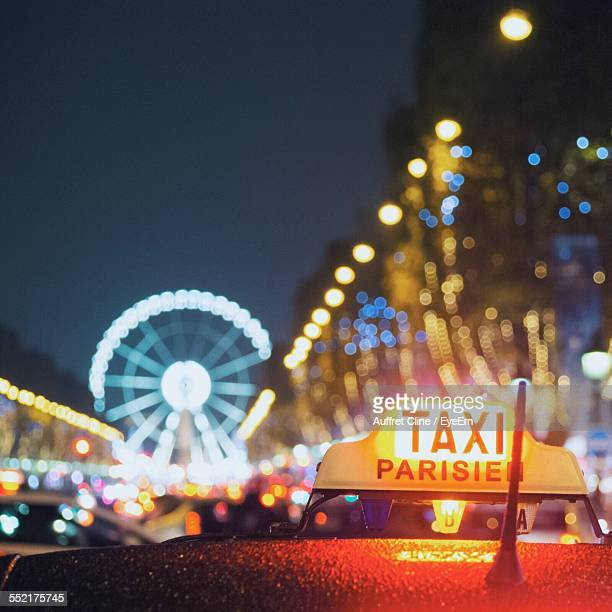 Close-Up Of Taxi Sign At Night