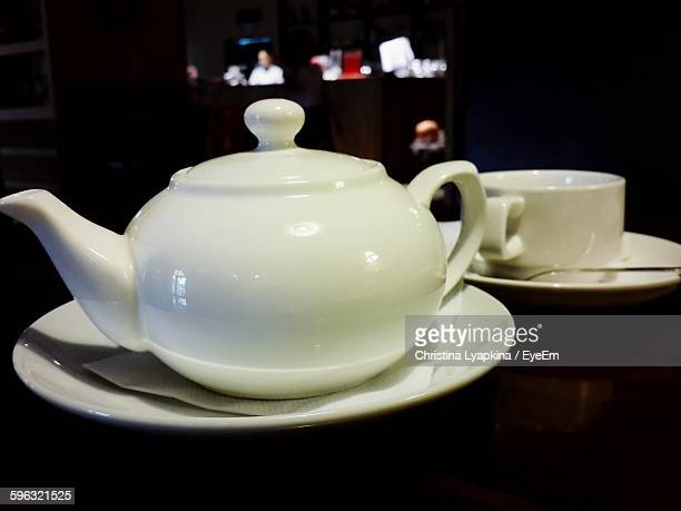 Close-Up Of Tea Kettle On Table At Home