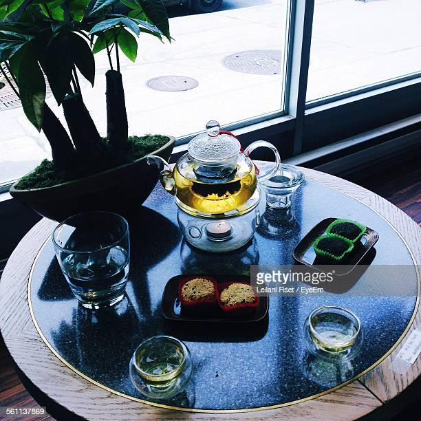 Close-Up Of Tea Served On Table With Cupcakes