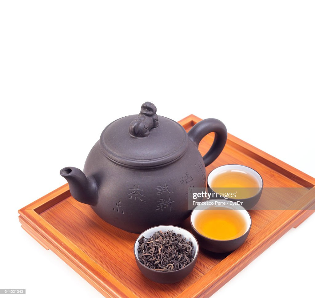 Close-Up Of Tea Set Over White Background