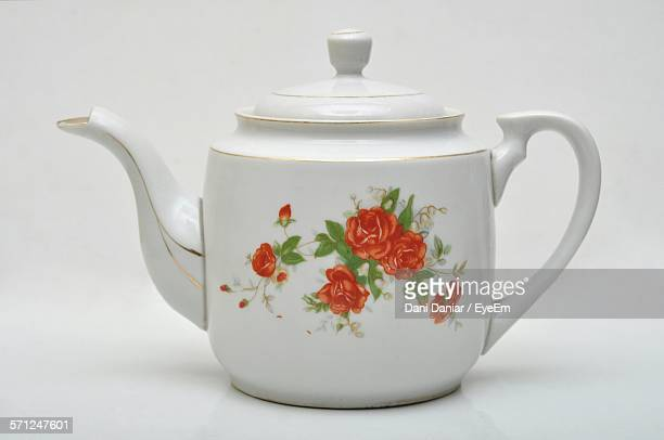 Close-Up Of Teapot Against White Background