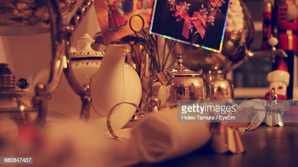 Close-up Of Teapots And Napkins With Decorations On Table