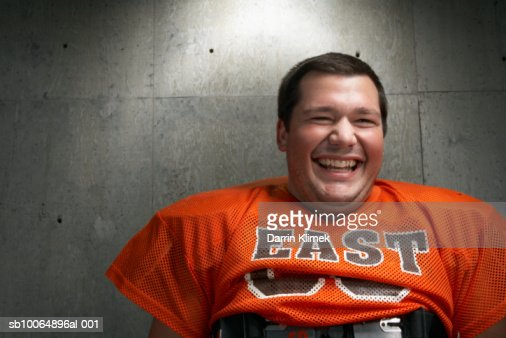 Close-up of teenage (16-17) American football player laughing : Stock Photo