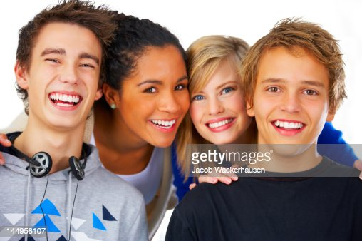 Close-up of teenage boys and girls laughing