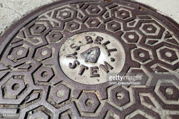 Closeup of telecommunications manhole cover with logo for telephone company Bell Systems Concord California September 8 2017