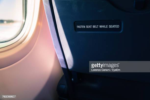 Close-Up Of Text On Airplane Seat