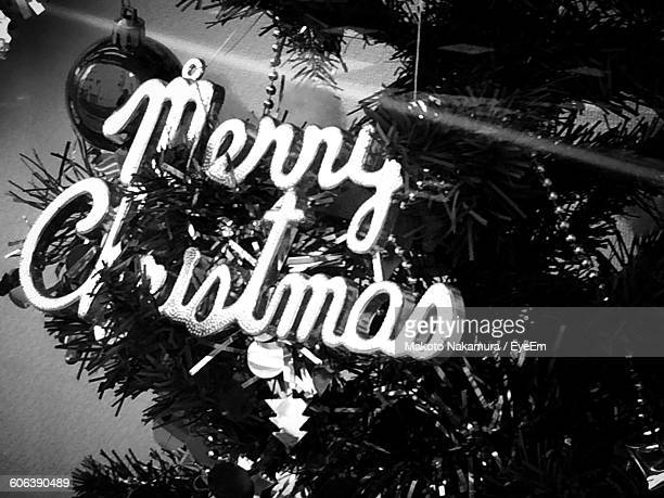 Close-Up Of Text On Christmas Tree At Night