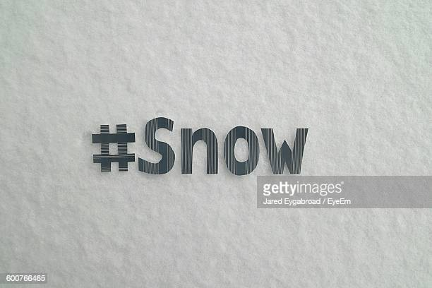 Close-Up Of Text On Snow Covered Field