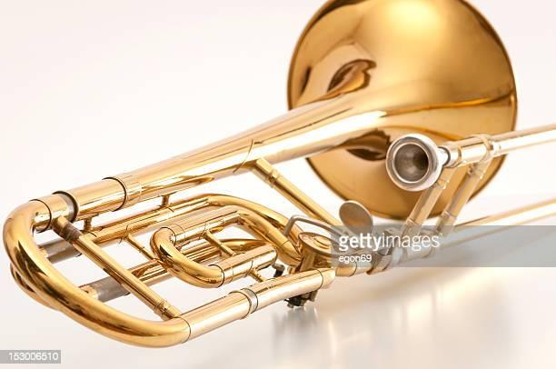 A closeup of the back of a golden trombone