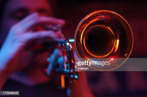 Close-up of the cone of a trumpet with player out of focus