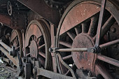 Close-up of the drive wheels and the drive rod of a historic steam locomotive