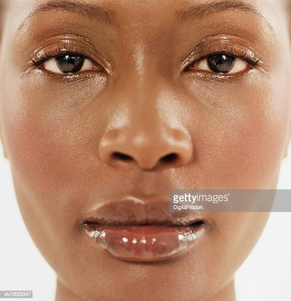 Close-up of the Face of a Woman Wearing Shiny Lip-gloss