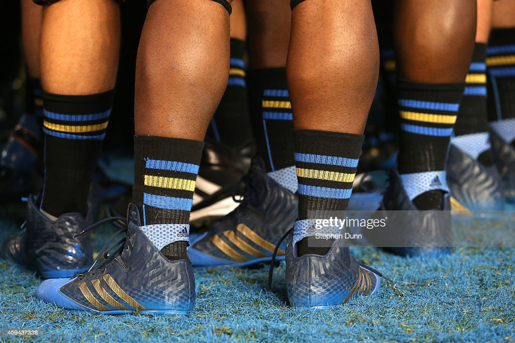 A closeup of the feet of members of the UCLA Bruins during warmups for the game against the USC Trojans at the Rose Bowl on November 22, 2014 in Pasadena, California. UCLA on 38-20.