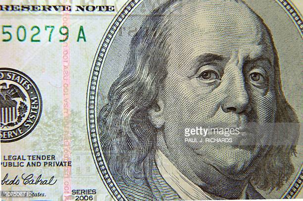 A closeup of the front of the United States 100dollar bill bearing the portrait of US statesman inventor and diplomat Benjamin Franklin is seen...