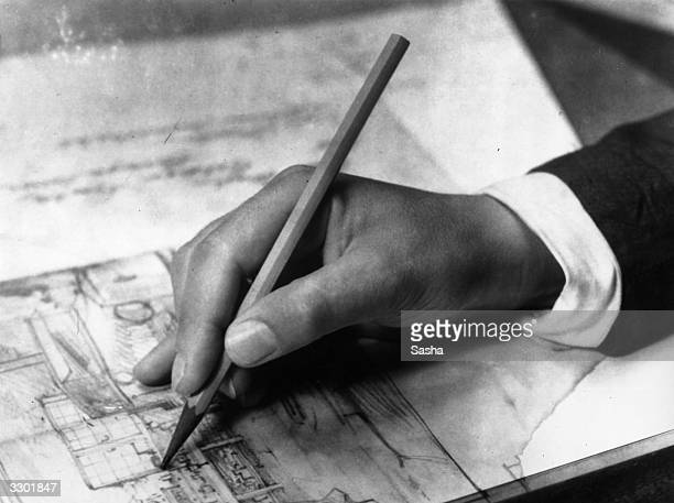 A closeup of the hand of an architect at work