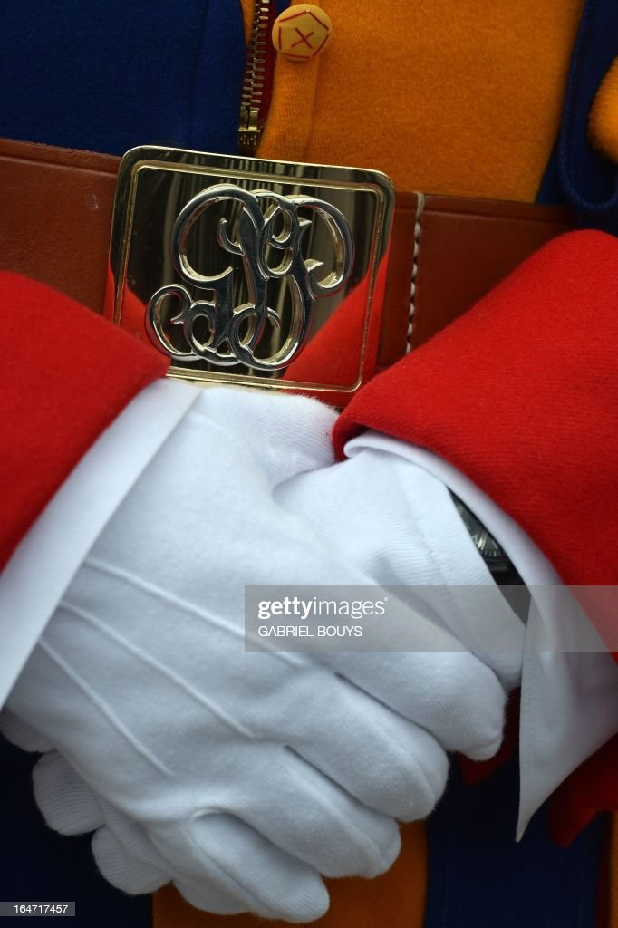 Close-up of the hands of a Swiss guard taken during a papal audience at St Peter's square on March 27, 2013 at the Vatican.