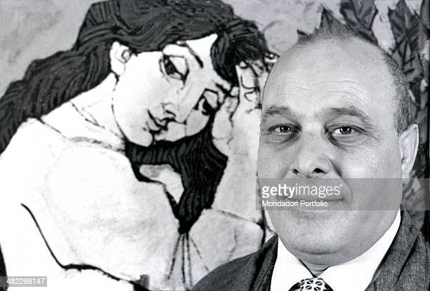 Closeup of the Italian painter Domenico Cantatore posing in front of one of his Odalisques theme the painter has explored from the early Fifties...