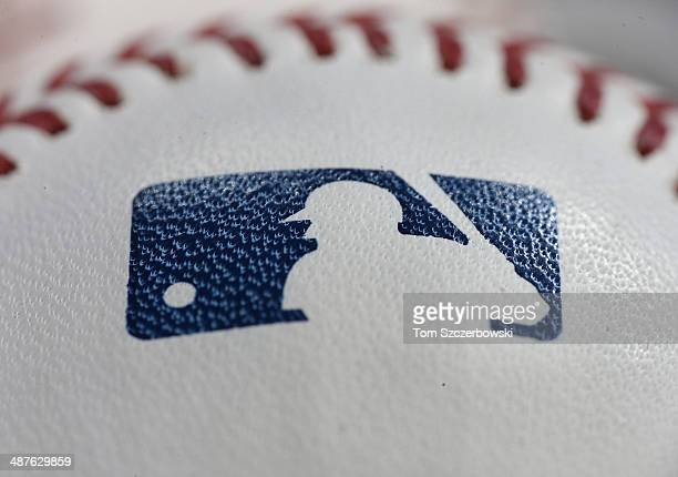 A closeup of the MLB logo on the dimpled surface of a baseball in a basket before the Baltimore Orioles MLB game against the Toronto Blue Jays on...