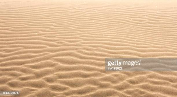 A close-up of the ripples left in the sand by the tide