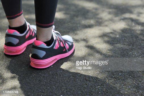 Close-up of the shoes of a woman wearing jogging s