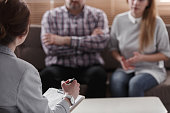 Close-up of therapist for couple analyzing behavior of spouses