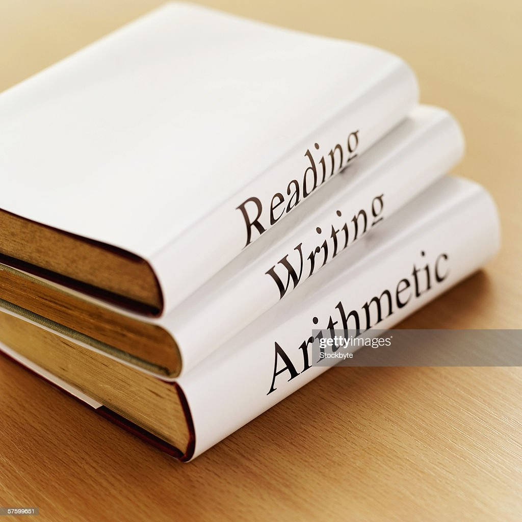 close-up of three books on a wooden surface : Stock Photo